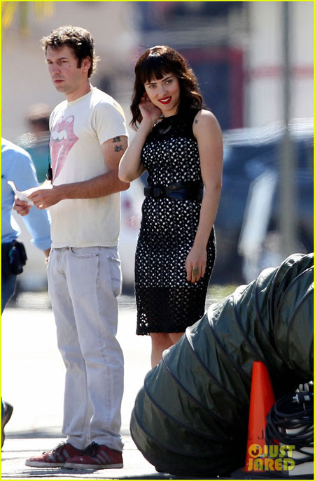 **EXCLUSIVE** FIRST ON SET PHOTOS: Scarlett Johansson shows off fake tattoos on her shoulders as she changes from short shorts and a tank top into a black dress and heels on the set of her new indie film 'Chef'
